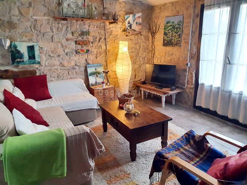 Sala d'estar de l'apartament per a dues persones de Can Pinyol